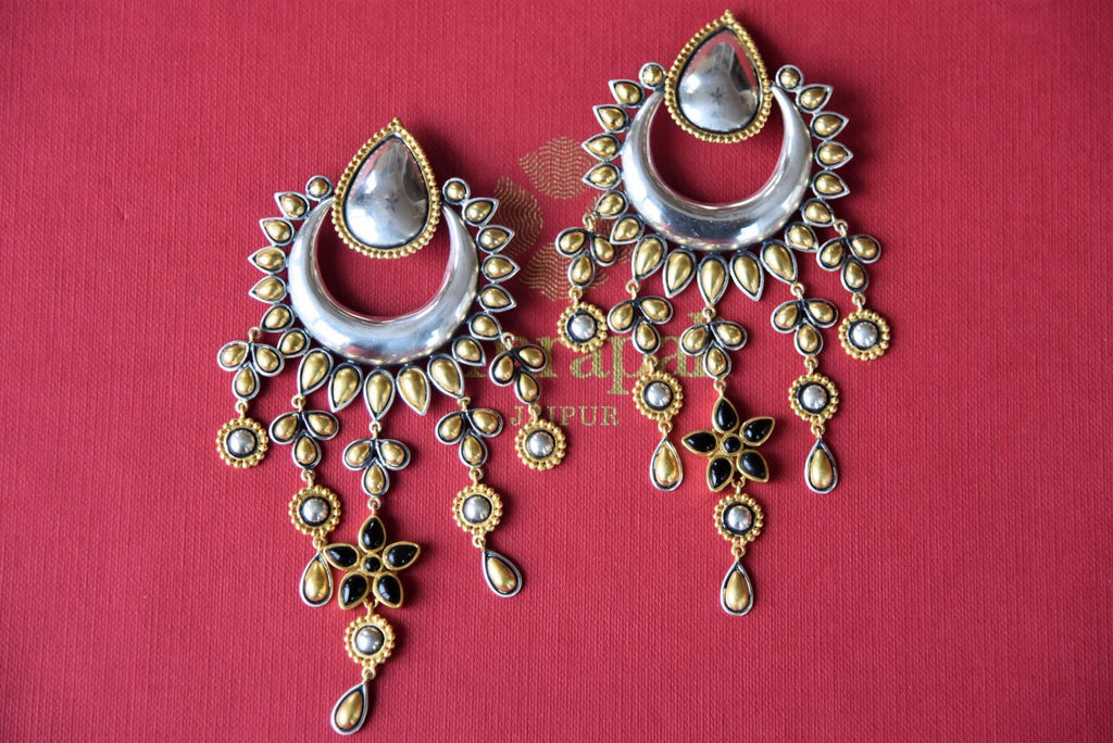 Shop silver gold plated Amrapali moon shape earrings online in USA with floral tassels. Get festival ready with a range of exquisite handcrafted Indian silver gold plated jewelry, ethnic silver jewelry from Pure Elegance Indian clothing store in USA.-flatlay
