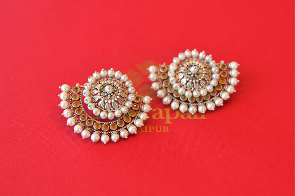 Shop Amrapali crescent shape citrine and pearl silver stud earrings online in USA from Pure Elegance. Complete your traditional look with an exquisite collection of Indian silver gold plated jewelry, silver jewelry, silver gold plated earrings and much more from our Indian fashion store in USA. -flatlay