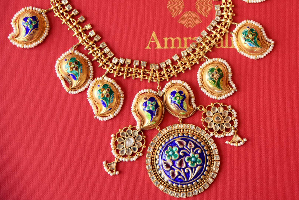 Buy Amrapali silver gold-plated glass and enamel necklace earrings set online in USA from Pure Elegance. Complete your traditional look with an exclusive collection of Indian traditional jewelry, silver gold plated necklaces, wedding jewellery available at our exclusive Indian fashion store in USA and also on our online store. Shop now.-flatlay