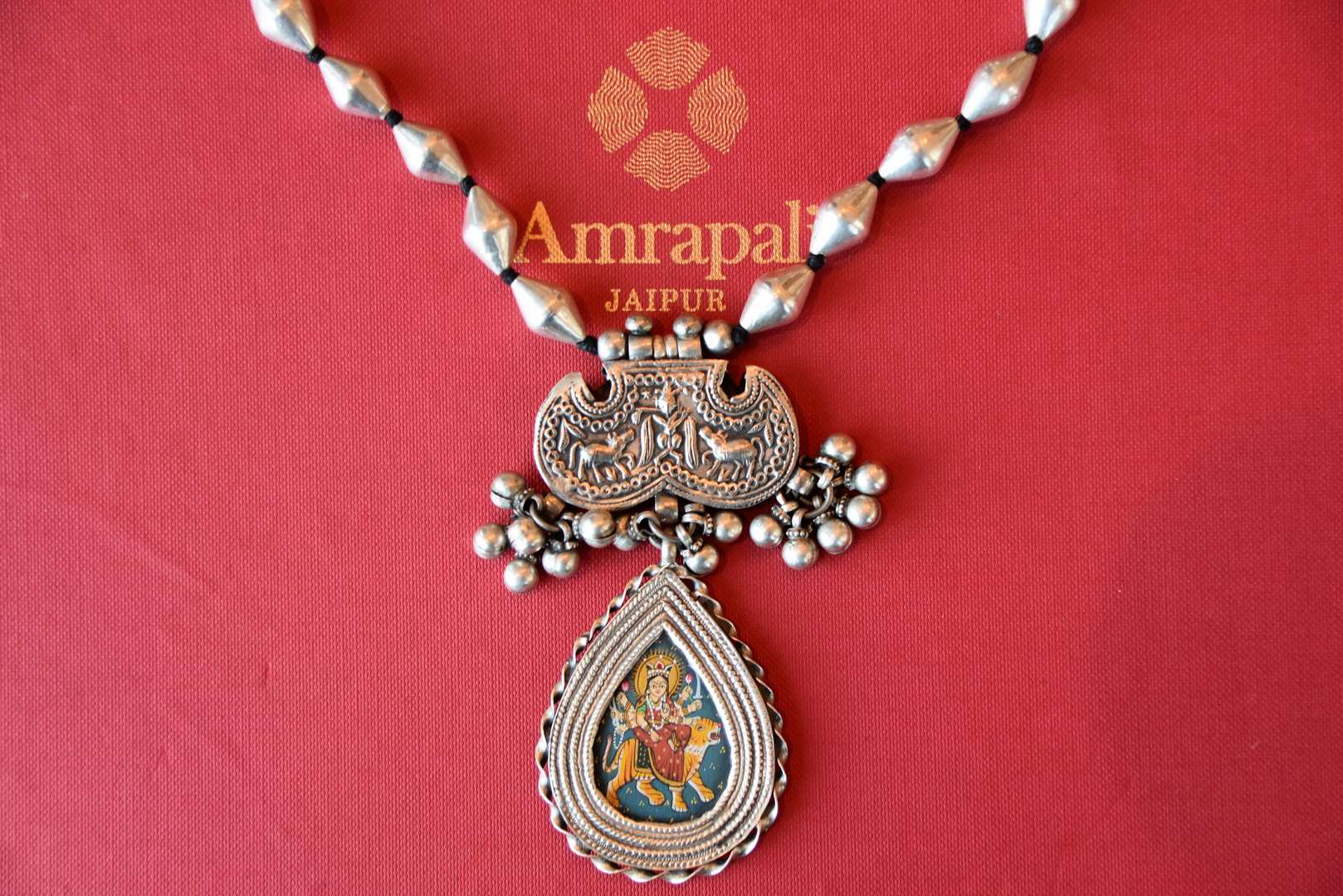 Buy Amrapali silver dholki thread necklace online in USA with Goddess Durga painting pendant. Add spark to your ethnic attires with beautiful Indian silver gold plated jewelry, wedding jewellery, silver necklaces from Pure Elegance Indian fashion store in USA.-flatlay