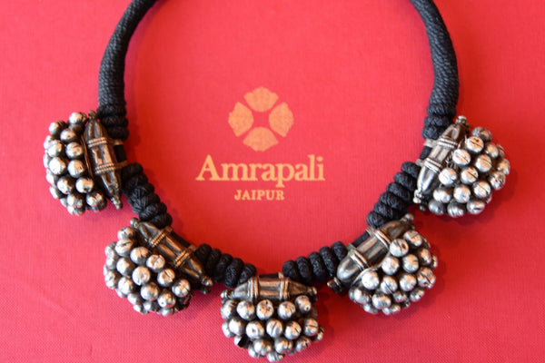 Shop Amrapali tribal silver beaded balls thread necklace online in USA. Add spark to your ethnic attires with beautiful Indian silver gold plated jewelry, wedding jewellery, silver necklaces from Pure Elegance Indian fashion store in USA.-flatlay