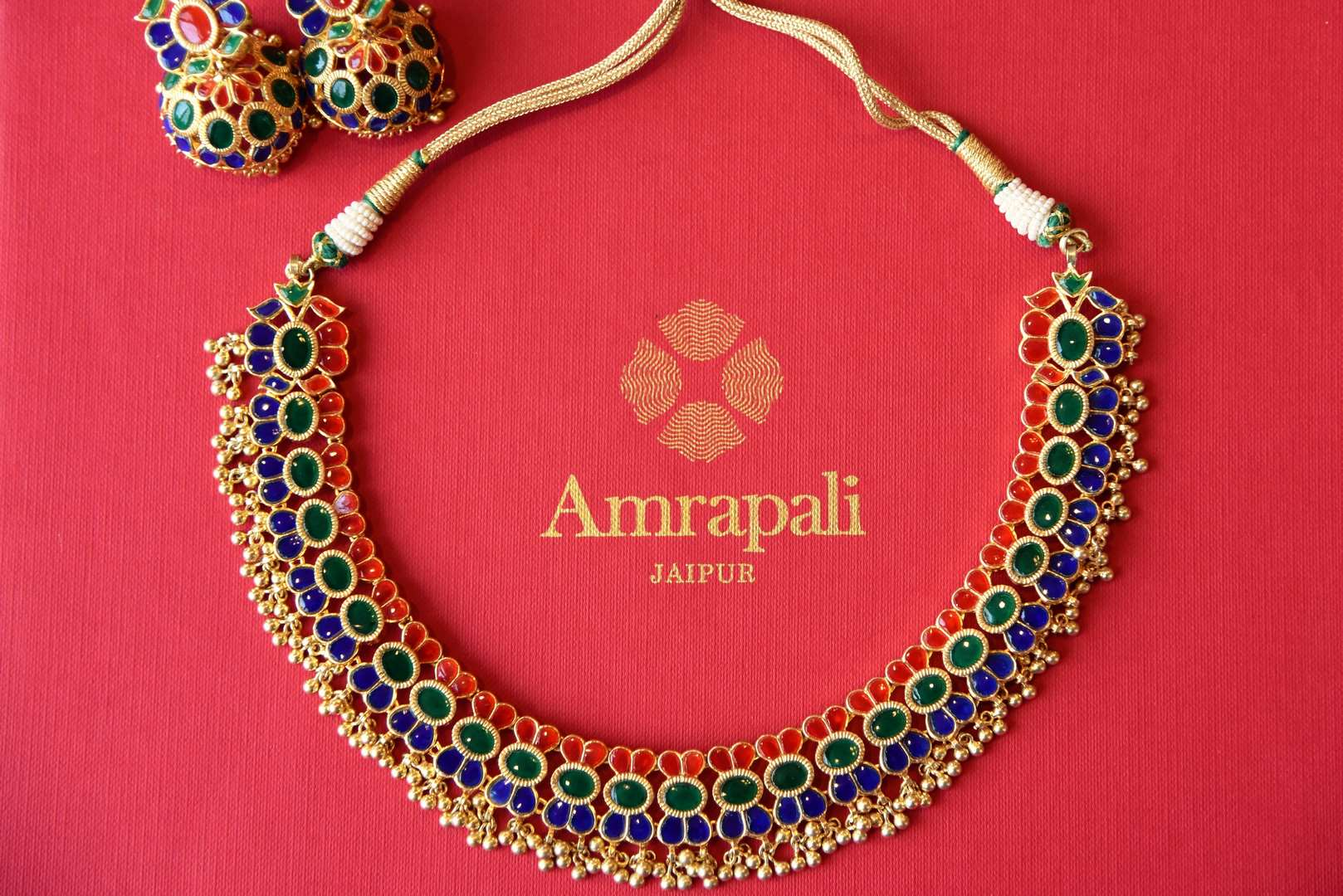 Shop Amrapali silver gold-plated multicolored glass necklace set online in USA from Pure Elegance. Complete your traditional look with an exclusive collection of Indian traditional jewelry, silver gold plated necklaces, wedding jewelry available at our exclusive Indian fashion store in USA and also on our online store. Shop now.-flatlay