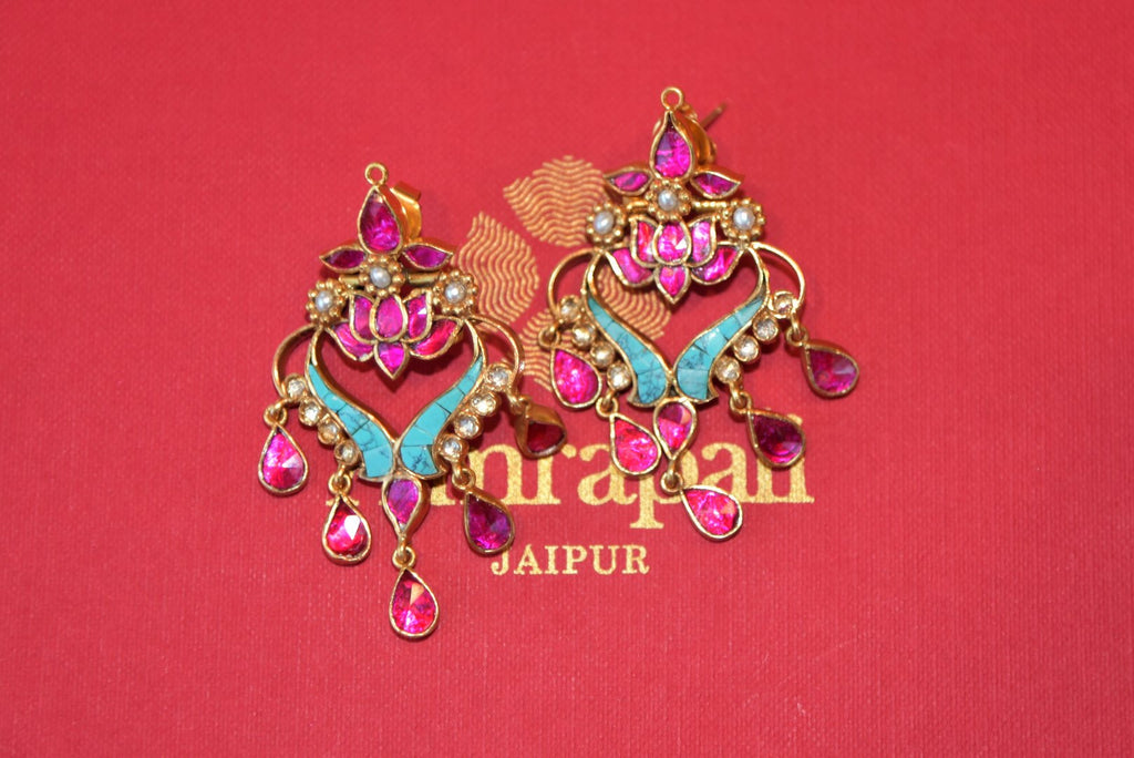 Shop Amrapali silver gold plated pink and turquoise stone earrings online in USA from Pure Elegance. Complete your traditional look with an exquisite collection of Indian silver gold plated jewelry, silver jewelry, silver gold plated earrings and much more from our Indian fashion store in USA. -flatlay