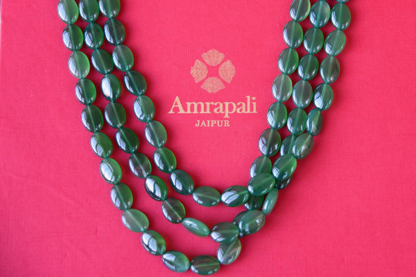 Shop Amrapali green stone three strings thread necklace online in USA. Add spark to your ethnic attires with beautiful Indian silver gold plated jewelry, wedding jewellery, silver necklaces from Pure Elegance Indian fashion store in USA.-flatlay