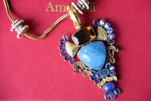 Shop silver gold plated Amrapali blue glass pendant necklace online in USA. Get festival ready with a range of exquisite handcrafted Indian silver gold plated jewellery, ethnic silver jewelry from Pure Elegance Indian clothing store in USA.-flatlay
