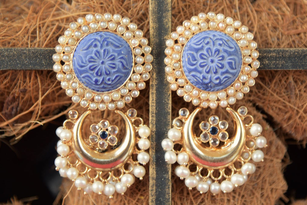Shop beautiful Amrapali gold plated earrings online in USA with engraved blue stone and pearls. Enhance your ethnic style with exquisite Indian jewelry from Pure Elegance Indian fashion store in USA. Pick from a range of stunning silver gold plated earrings, silver gold plated necklaces, silver jewelry for a perfect...-front