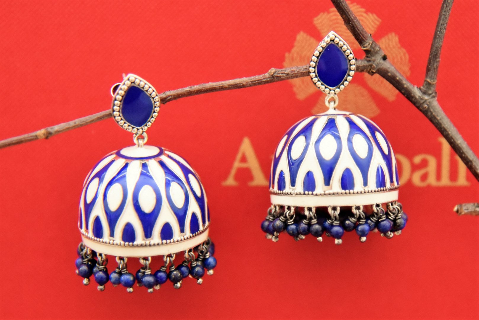 Buy blue and white enamel big silver jhumki online in USA with hanging blue beads. Find an exquisite collection of handcrafted Indian jewelry in USA at Pure Elegance Indian fashion store. Complete your festive look with beautiful silver gold plated necklaces, silver earrings, silver jewelry from our online store.-front