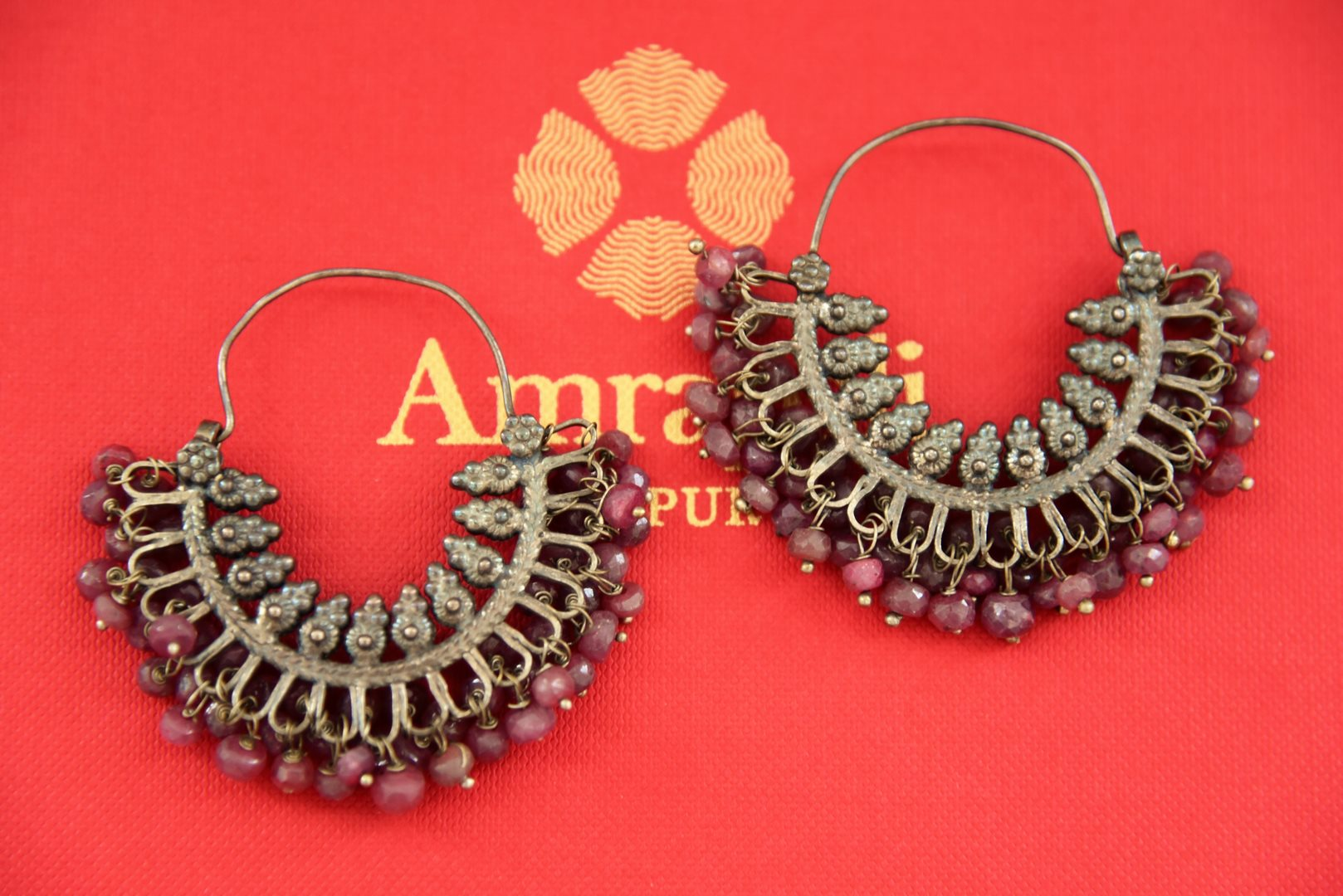 Shop Amrapali antique silver hoop earrings online in USA with pink stones. Find an exquisite collection of handcrafted Indian jewelry in USA at Pure Elegance Indian fashion store. Complete your festive look with beautiful silver gold plated necklaces, silver gold plated earrings, silver jewelry from our online store.-front