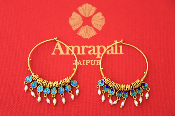 Buy Amrapali silver gold plated blue enamel hoop earrings online in USA with pearl beads. Find an exquisite collection of handcrafted Indian jewelry in USA at Pure Elegance Indian fashion store. Complete your festive look with beautiful silver gold plated necklaces, silver gold plated earrings, silver jewelry from our online store.-front