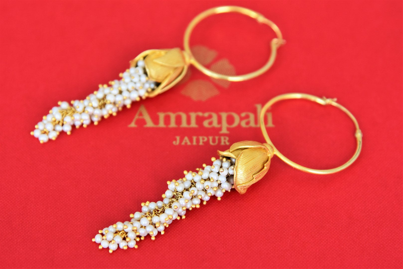Buy Amrapali silver gold plated hoop earrings online in USA with clustered pearls tassels. Find an exquisite collection of handcrafted Indian jewelry in USA at Pure Elegance Indian fashion store. Complete your festive look with beautiful silver gold plated necklaces, silver gold plated earrings, silver jewelry from our online store.-flatlay