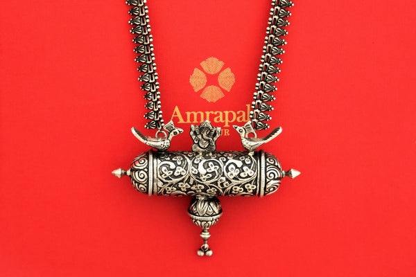 Buy Amrapali oxidized traditional silver necklace online in USA. Find an exquisite collection of handcrafted Indian jewelry in USA at Pure Elegance Indian fashion store. Complete your festive look with beautiful silver necklaces, silver gold plated earrings, silver jewelry from our online store.-front