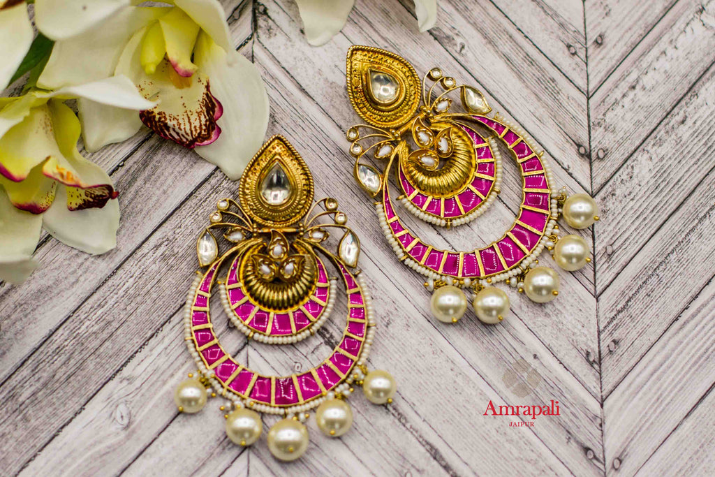 Buy Amrapali silver gold plated glass pearl chandbali earrings online in USA. Complete your ethnic look with traditional Indian silver gold plated jewelry from Pure Elegance Indian fashion store in USA. Shop gold plated necklaces, wedding jewelry for Indian brides in USA from our online store.-flatlay
