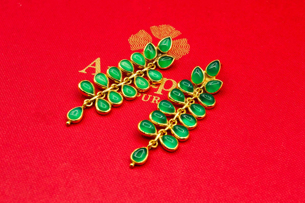 Buy Amrapali silver gold plated green stone leaf earrings online in USA. Raise your traditional fashion quotient on special occasions with exquisite Indian jewelry from Pure Elegance Indian clothing store in USA. Enhance your look with silver gold plated jewelry, fashion jewelry available online.-flatlay