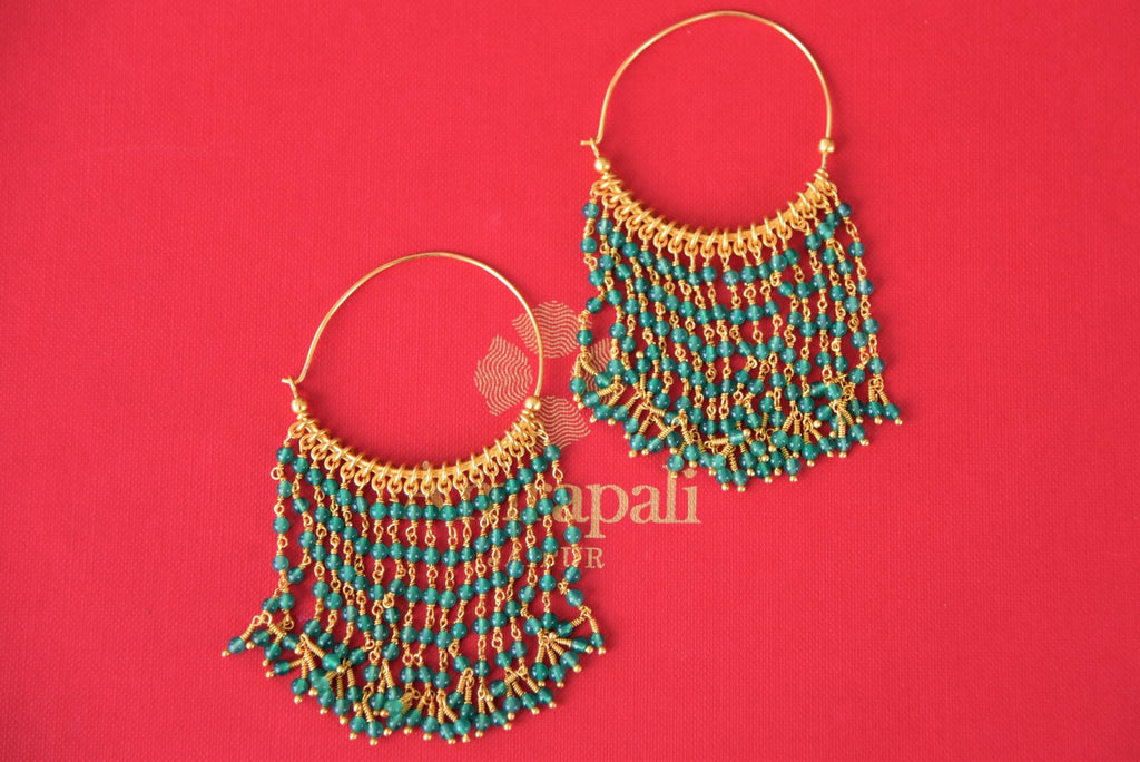 Buy silver gold plated Amrapali hoop earrings online in USA with green beads tassels. Enhance your ethnic style with exquisite Indian jewelry from Pure Elegance Indian fashion store in USA. Pick from a range of stunning silver gold plated earrings, silver gold plated necklaces, silver jewelry for a perfect finishing...-front