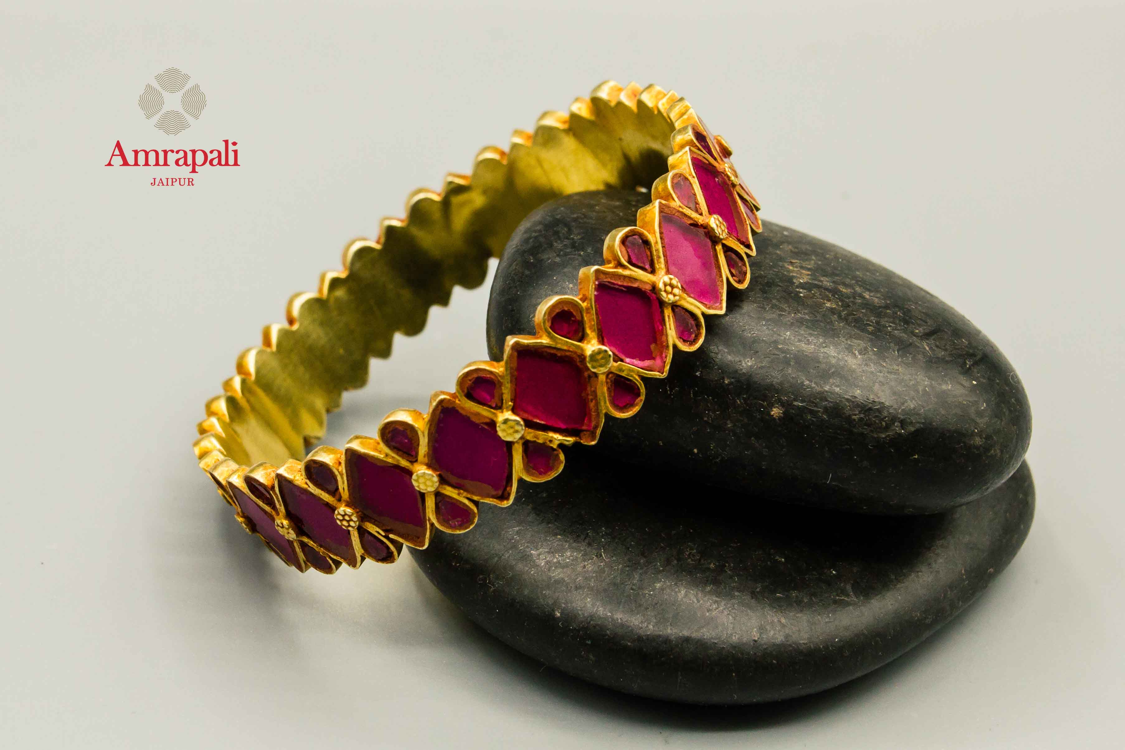 Shop Amrapali silver gold plated pink glass bangle online in USA. Raise your traditional fashion quotient on special occasions with exquisite Indian jewelry from Pure Elegance Indian clothing store in USA. Enhance your look with silver gold plated jewelry, fashion jewelry available online.-flatlay