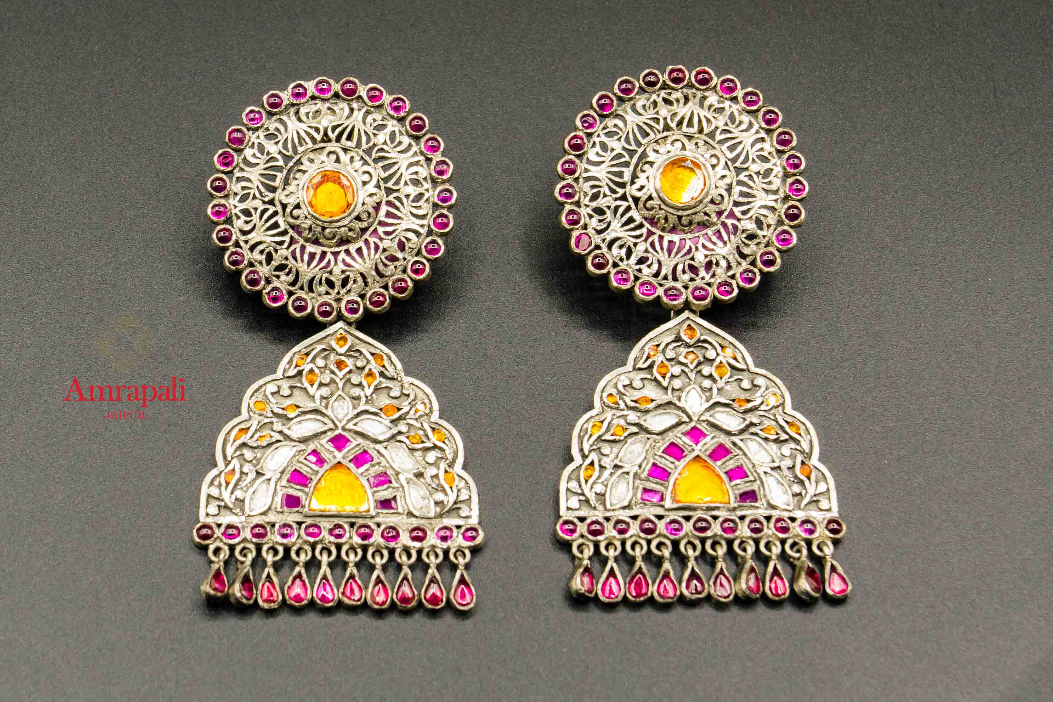 Shop Amrapali pink and yellow glass silver earrings online in USA. Raise your traditional fashion quotient on special occasions with exquisite Indian jewelry from Pure Elegance Indian clothing store in USA. Enhance your look with silver gold plated jewelry, fashion jewelry available online.-flatlay
