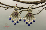 Buy Amrapali glass silver earrings online in USA with blue stone drops. Raise your traditional fashion quotient on special occasions with exquisite Indian jewelry from Pure Elegance Indian clothing store in USA. Enhance your look with silver gold plated jewelry, fashion jewelry available online.-front
