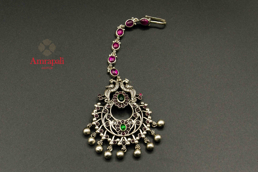 Buy Amrapali silver maangtikka online in USA with pink and green stones. Raise your traditional fashion quotient on special occasions with exquisite Indian jewelry from Pure Elegance Indian clothing store in USA. Enhance your look with silver gold plated jewelry, silver jewelry available online.-flatlay