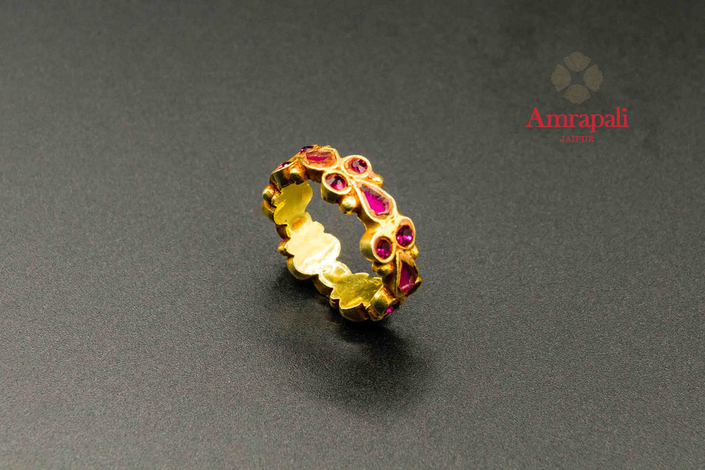 Buy Amrapali pink glass silver gold plated ring online in USA. Raise your traditional fashion quotient on special occasions with exquisite Indian jewelry from Pure Elegance Indian clothing store in USA. Enhance your look with silver gold plated jewelry, silver jewellery available online.-flatlay