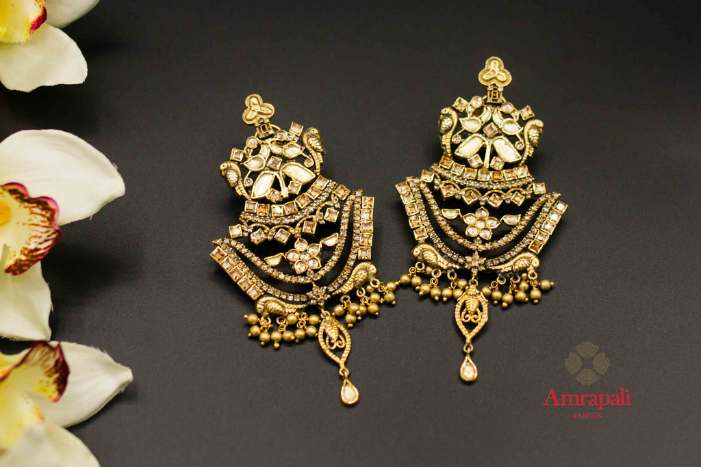 Shop Amrapali silver gold plated glass chandelier earrings online in USA. Raise your ethnic style quotient on special occasions with exquisite Indian jewelry from Pure Elegance Indian clothing store in USA. Enhance your Indian look with silver gold plated jewelry, necklaces, silver jewelry available online.-flatlay