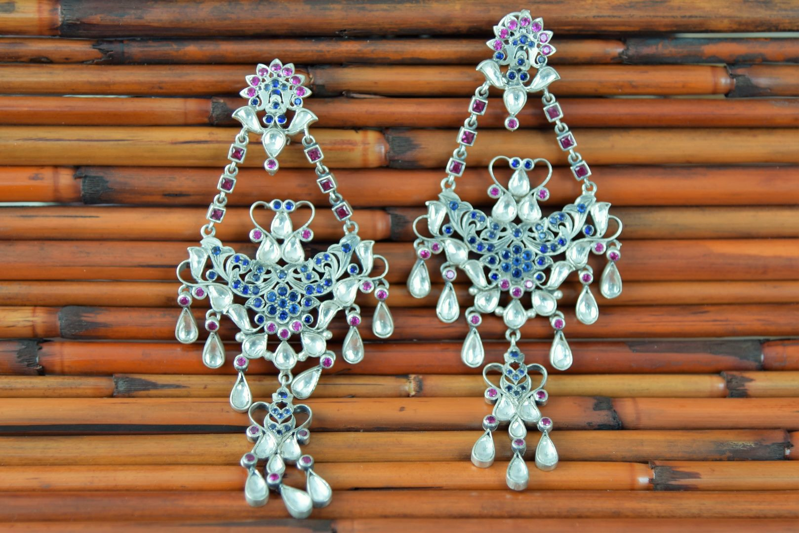 Buy multicolor glass Amrapali silver chandelier earrings online in USA. Enhance your ethnic style with exquisite Indian jewelry from Pure Elegance Indian fashion store in USA. Pick from a range of stunning silver gold plated earrings, silver gold plated necklaces, silver jewelry for a perfect finishing...-closeup