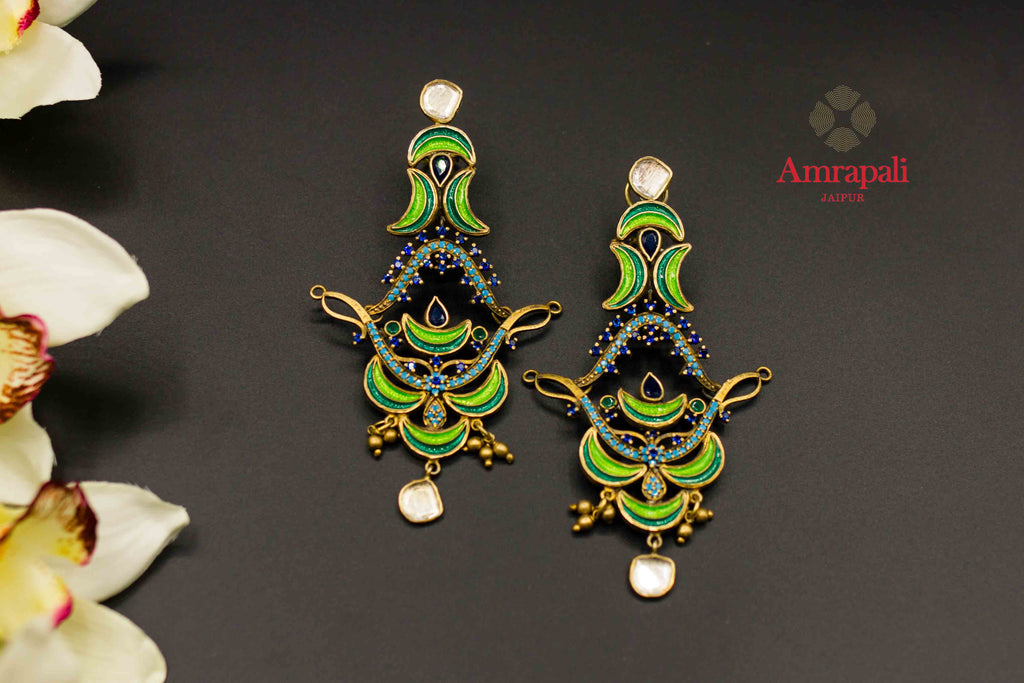 Shop Amrapali vibrant enamel and glass silver gold plated earrings online in USA. Raise your ethnic style quotient on special occasions with exquisite Indian jewelry from Pure Elegance Indian clothing store in USA. Enhance your Indian look with silver gold plated jewelry, necklaces, silver jewelry available online.-flatlay