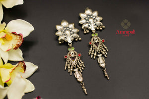 Buy Amrapali flower top silver earrings online in USA with colored stones. Raise your ethnic style quotient on special occasions with exquisite Indian jewelry from Pure Elegance Indian clothing store in USA. Enhance your Indian look with silver gold plated jewelry, necklaces, silver jewelry available online.-flatlay
