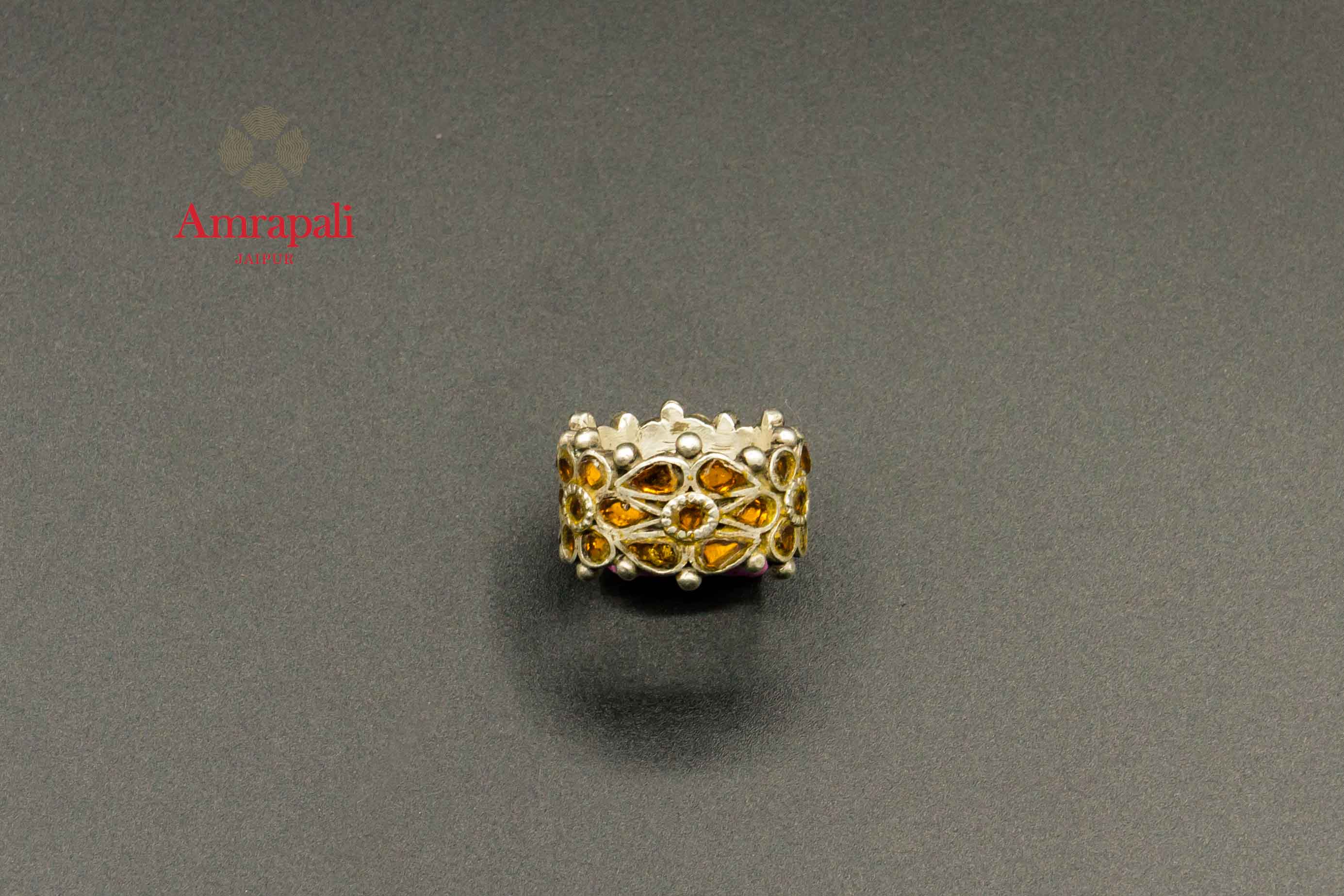 Shop Amrapali yellow glass silver ring online in USA. Raise your traditional fashion quotient on special occasions with exquisite Indian jewelry from Pure Elegance Indian clothing store in USA. Enhance your look with silver gold plated jewelry, silver jewellery available online.-flatlay