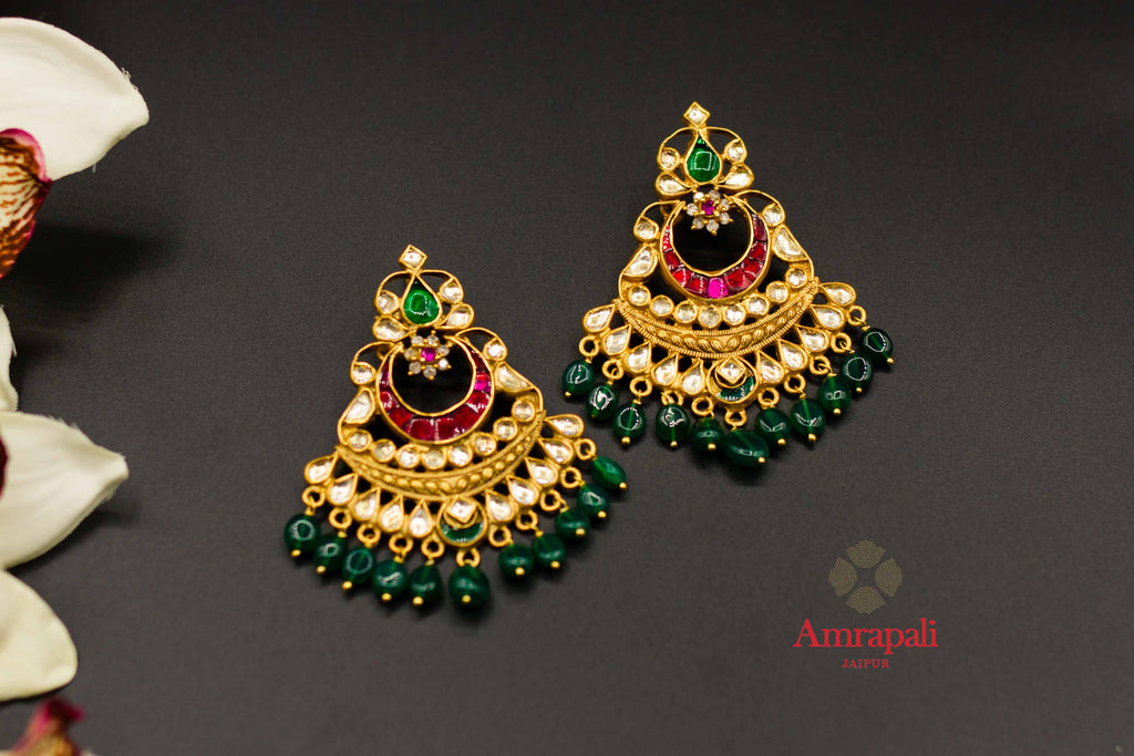 Shop Amrapali kundan and green stones silver gold plated earrings online in USA. Raise your ethnic style quotient on special occasions with exquisite Indian jewelry from Pure Elegance Indian clothing store in USA. Enhance your Indian look with silver gold plated jewelry, necklaces, fashion jewelry available online.-flatlay
