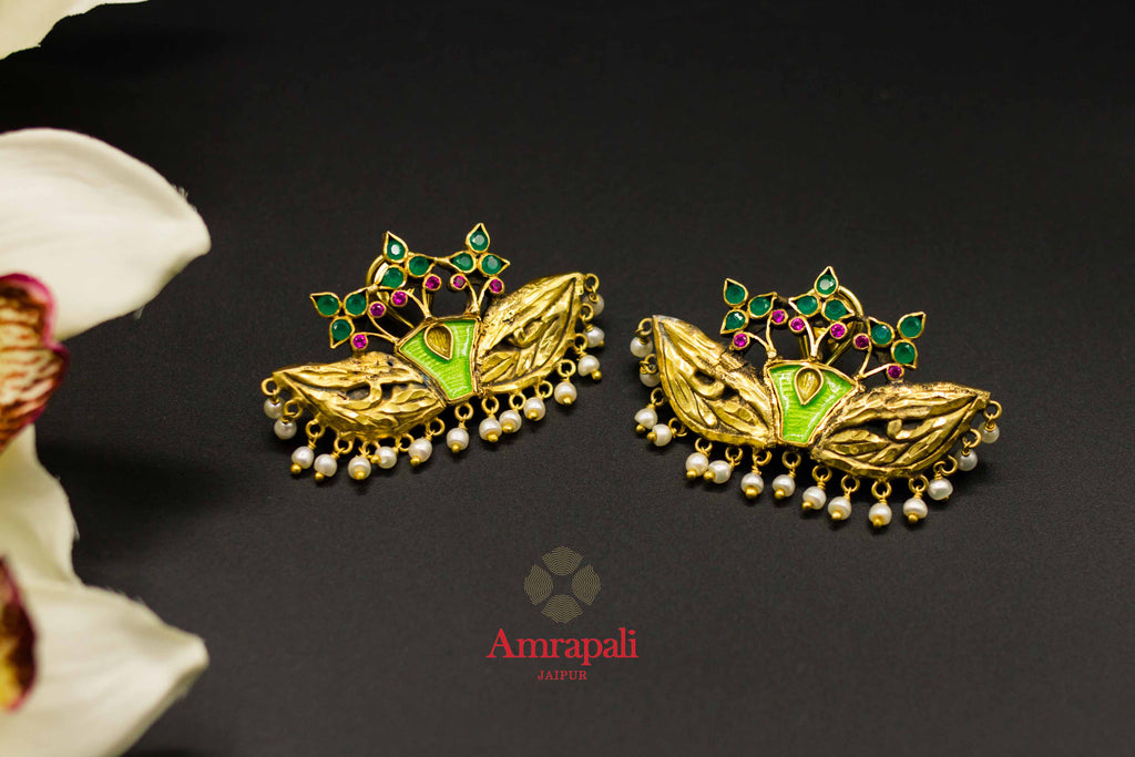 Buy Amrapali masquerade mask design silver gold plated earrings online in USA. Raise your ethnic style quotient on special occasions with exquisite Indian jewelry from Pure Elegance Indian clothing store in USA. Enhance your Indian look with silver gold plated jewelry, necklaces, fashion jewelry available online.-flatlay