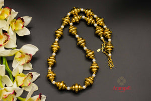 Shop Amrapali silver gold plated beads and pearls necklace online in USA. Raise your ethnic style quotient on special occasions with exquisite Indian jewelry from Pure Elegance Indian clothing store in USA. Enhance your Indian look with silver gold plated jewelry, necklaces, fashion jewelry available online.-flatlay