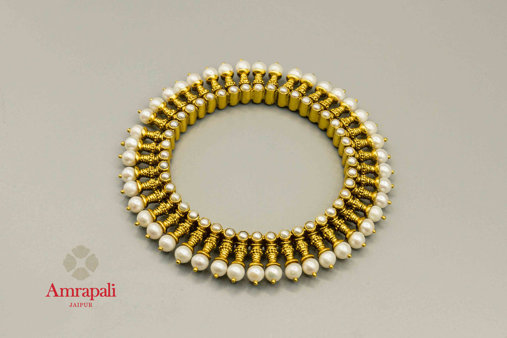 Buy Amrapali silver gold plated spiky pearl bangle online in USA. Raise your traditional fashion quotient on special occasions with exquisite Indian jewelry from Pure Elegance Indian clothing store in USA. Enhance your look with silver gold plated jewellery, silver jewellery available online.-flatlay