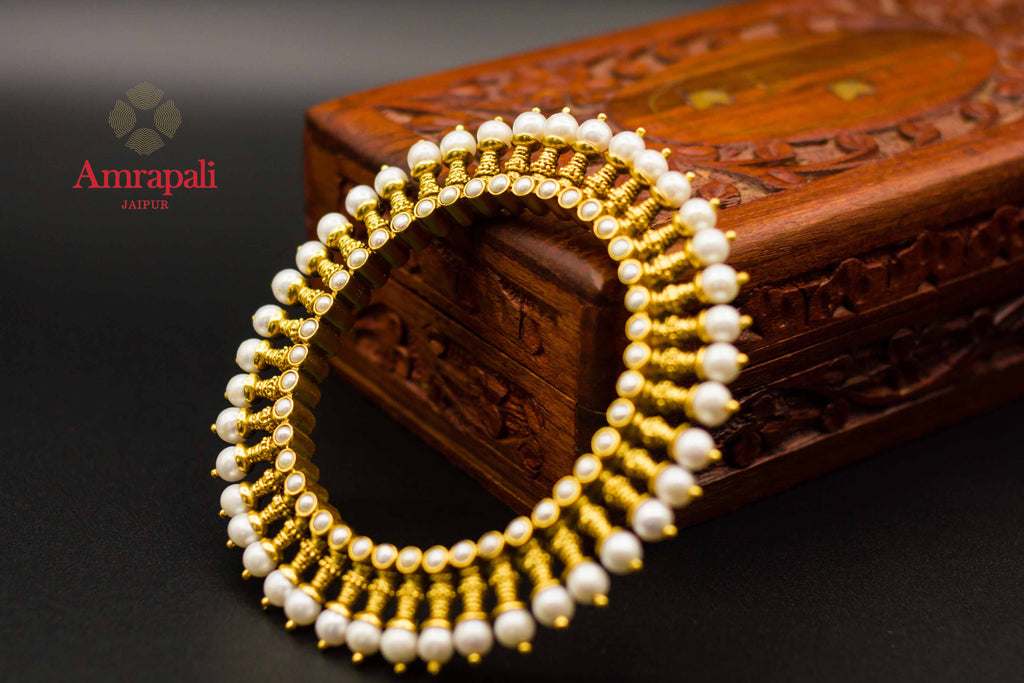 Shop Amrapali heavy silver gold plated spiky pearl bangle online in USA. Raise your ethnic style quotient on special occasions with exquisite Indian jewelry from Pure Elegance Indian clothing store in USA. Enhance your Indian look with silver gold plated jewelry, necklaces, fashion jewelry available online.-side view