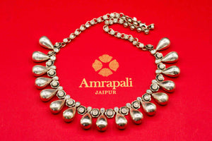 Shop Amrapali drop and flower silver necklace online in USA. Raise your ethnic style quotient on special occasions with exquisite Indian jewelry from Pure Elegance Indian clothing store in USA. Enhance your Indian look with silver gold plated jewelry, necklaces, fashion jewelry available online.-flatlay
