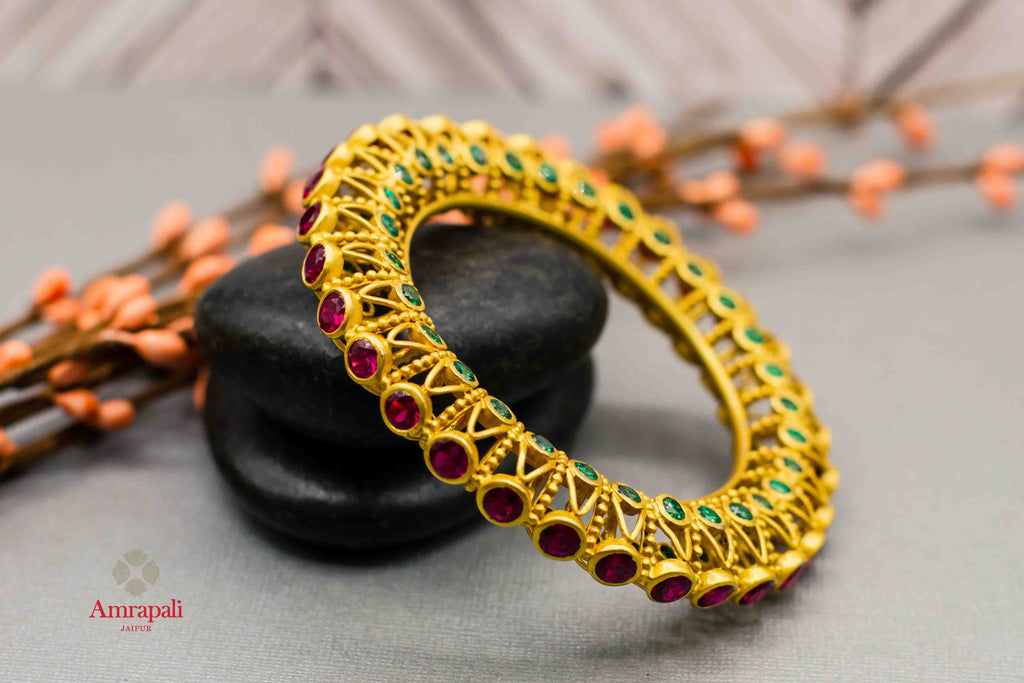 Buy Amrapali colored stones silver gold plated bangle online in USA. Complete your ethnic look with traditional Indian jewelry from Pure Elegance Indian fashion store in USA. Shop silver jewelry, wedding jewelry for Indian brides in USA from our online store.-front