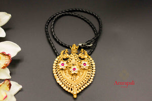 Buy Amrapali silver gold plated Ganesha peacock glass pendant necklace online in USA. Raise your ethnic style quotient on special occasions with exquisite Indian jewelry from Pure Elegance Indian clothing store in USA. Enhance your Indian look with silver gold plated jewelry, fashion jewelry available online.-flatlay