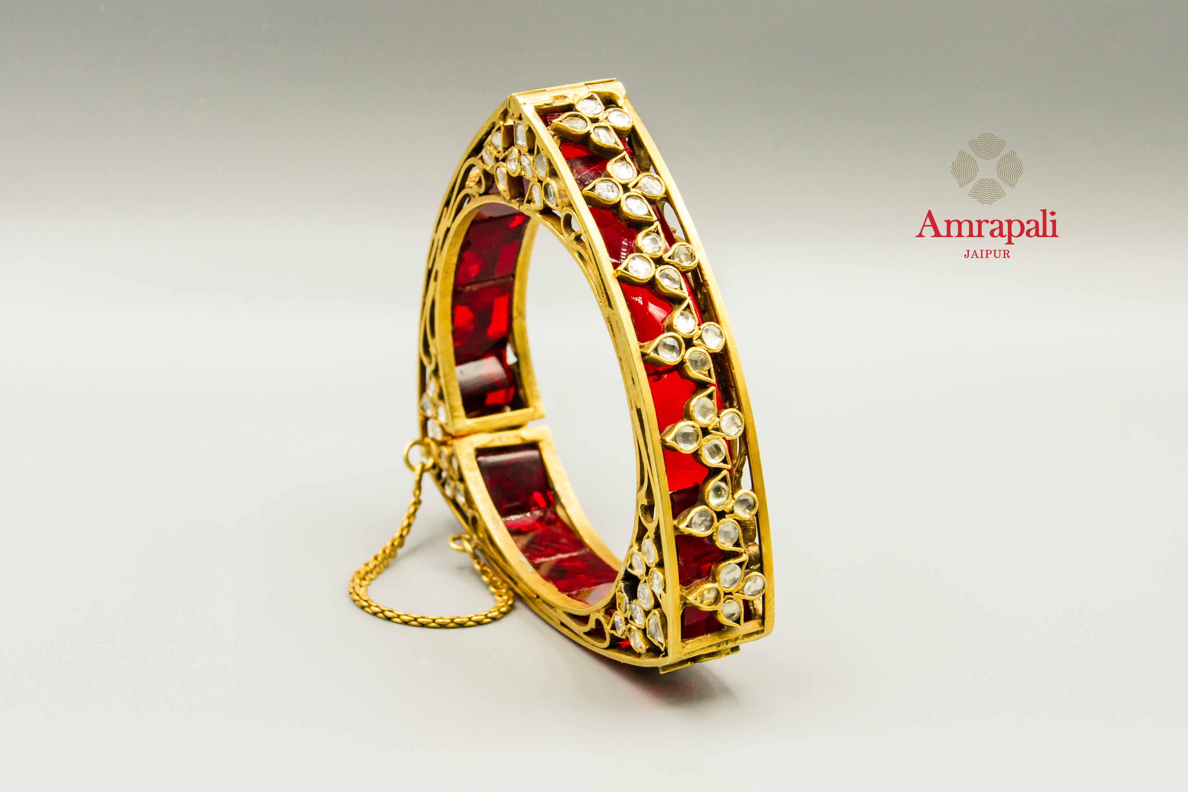 Shop Amrapali silver gold plated triangle red glass bangle online in USA. Raise your traditional fashion quotient on special occasions with exquisite Amrapali jewelry from Pure Elegance Indian clothing store in USA. Enhance your look with Indian silver gold plated jewelry, wedding jewellery available online.-front