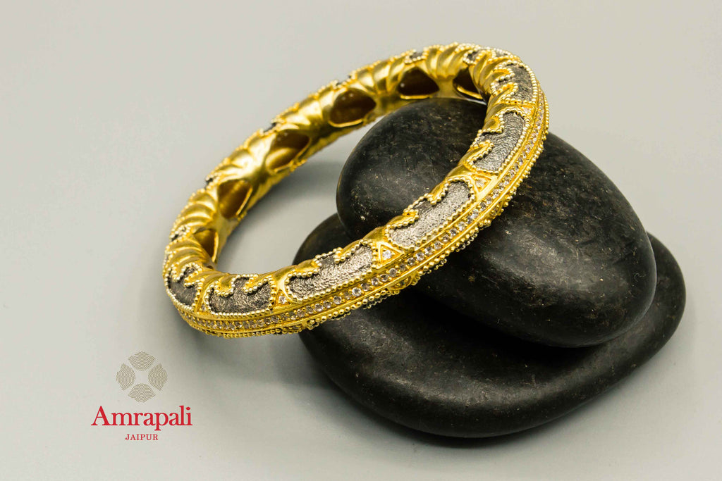 Buy Amrapali silver gold plated two-tone textured bangle online in USA. Raise your traditional fashion quotient on special occasions with exquisite Indian jewelry from Pure Elegance Indian clothing store in USA. Enhance your look with silver gold plated jewelry, wedding jewellery available online.-flatlay