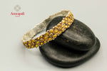 Buy Amrapali silver gold plated two-tone flower design bangle online in USA. Raise your traditional fashion quotient on special occasions with exquisite Amrapali jewelry from Pure Elegance Indian clothing store in USA. Enhance your look with Indian silver gold plated jewelry, wedding jewellery available online.-flatlay