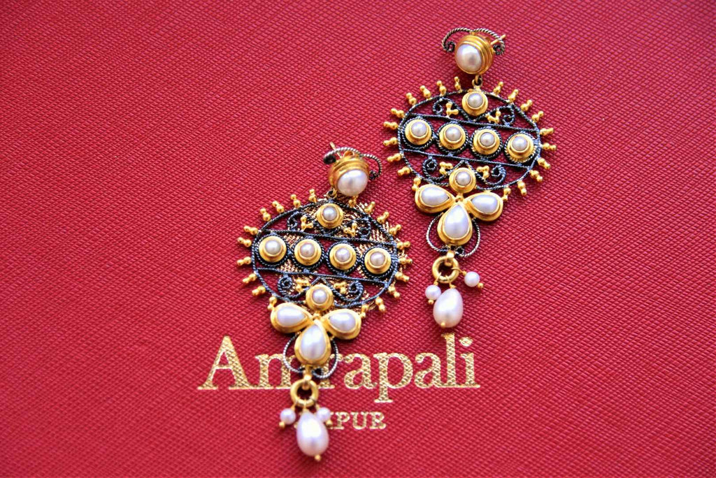 Buy stunning gold plated two-tone pearl drop earrings online in USA. Pure Elegance Indian fashion store presents an exquisite collection of Amrapali silver jewelry in USA for Indian women. Shop now.-flatlay