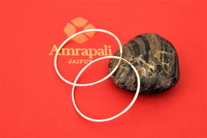 Shop Amrapali silver bali earrings  online in USA. Choose from a beautiful range of Indian jewellery, silver jewelry, silver earrings, gold plated jewelry from Pure Elegance Indian fashion store in USA.-flatlay