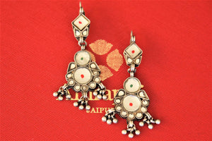 Buy gorgeous oxidized silver white glass Amrapali earrings online in USA. Shop designer Amrapali jewelry in USA from Pure Elegance Indian fashion store. Choose from a colorful and exquisite variety of gold plated earrings, gold plated necklaces, silver gold plated jewelry for special occasions.-flatlay
