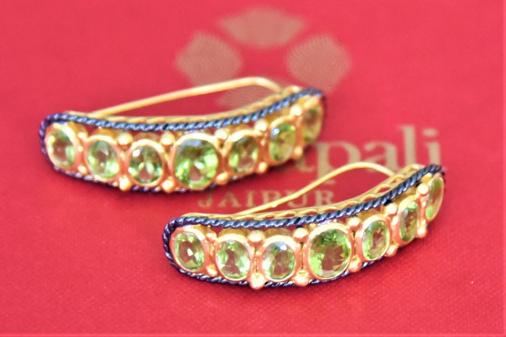 Shop Amrapali silver gold plated two-tone green stone earrings online in USA. Complete your traditional style with exquisite gold plated jewelry from Pure Elegance Indian fashion store in USA.-flatlay