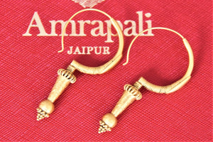 Shop Amrapali silver gold plated spiky bali earrings online in USA. Give yourself a beautiful traditional makeover this wedding season with exquisite gold plated jewellery from Pure Elegance Indian fashion boutique in USA.-flatlay