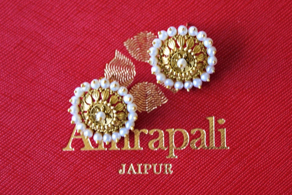Shop gorgeous Amrapali silver gold plated floral studs online in USA. Elevate your ethnic attires with exquisite Indian jewelery, silver earrings, silver gold plated necklaces from Pure Elegance Indian fashion store in USA.-flatlay