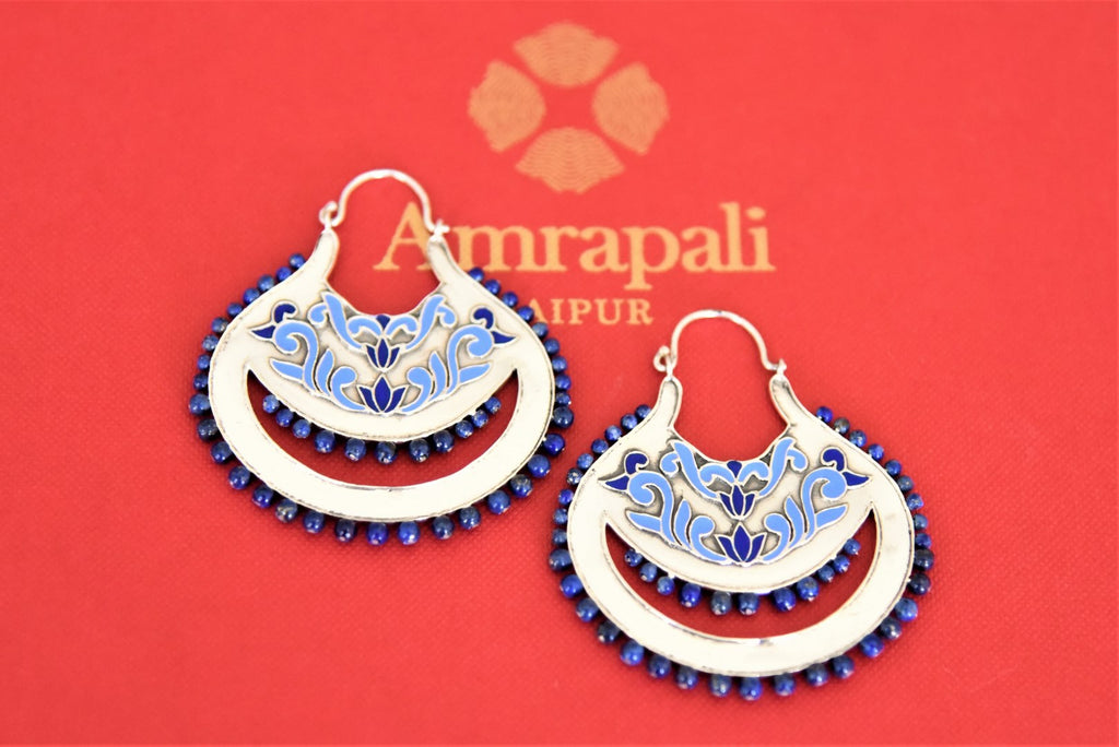 Buy Amrapali silver blue enamel chandbali earrings online in USA with blue stones. Complete your traditional style with exquisite silver jewelry from Pure Elegance Indian fashion store in USA.-flatlay