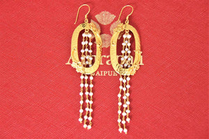 Buy beautiful Amrapali silver gold plated earrings online in USA with pearl tassels. Give yourself a beautiful traditional makeover this wedding season with exquisite gold plated jewellery, silver jewelry from Pure Elegance Indian fashion boutique in USA.-flatlay