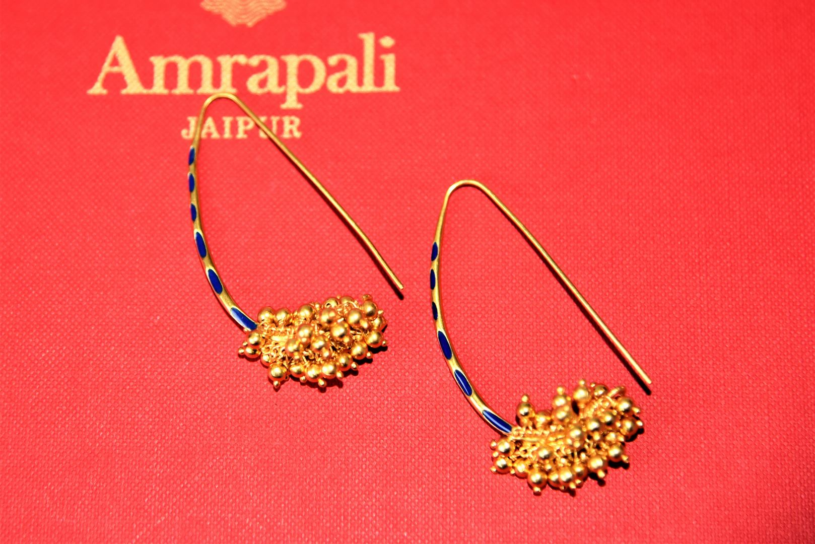 Buy beautiful Amrapali silver gold plated earrings online in USA with cluster beads. Choose from a beautiful range of Indian jewelry, silver jewelry, silver earrings, gold plated jewelry from Pure Elegance Indian fashion store in USA.-flatlay
