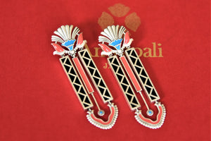 Buy Amrapali silver black and pink enamel contemporary earrings online in USA with black beads tassels. Complete your traditional style with exquisite gold plated jewelry from Pure Elegance Indian fashion store in USA.-flatlay