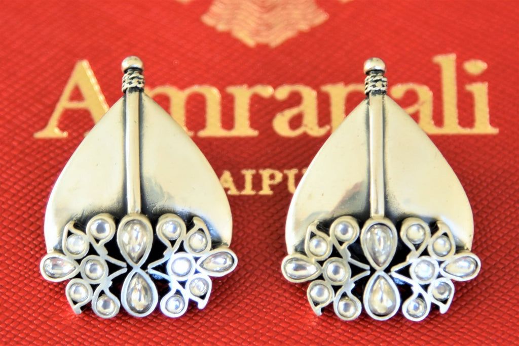Shop Amrapali glass and silver leaf shape earrings online in USA. Shop designer Amrapali jewelry in USA from Pure Elegance Indian fashion store. Choose from a colorful and exquisite variety of gold plated earrings, gold plated necklaces, silver gold plated jewelry for special occasions.-flatlay